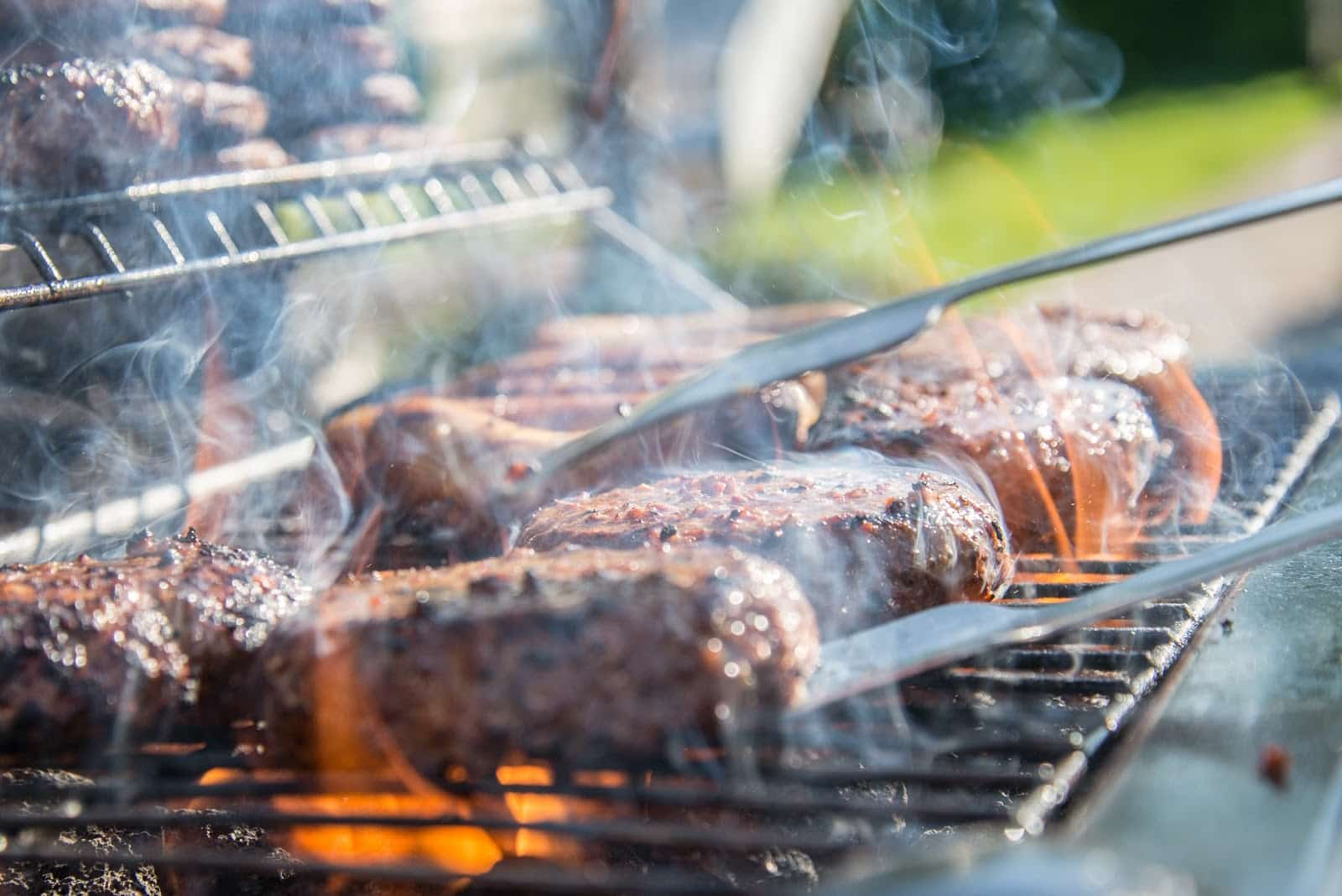 close photography of grilled meat on griddle 1105325